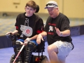 Alex Pitts getting instruction from his dad - 2016 Powerhockey Cup